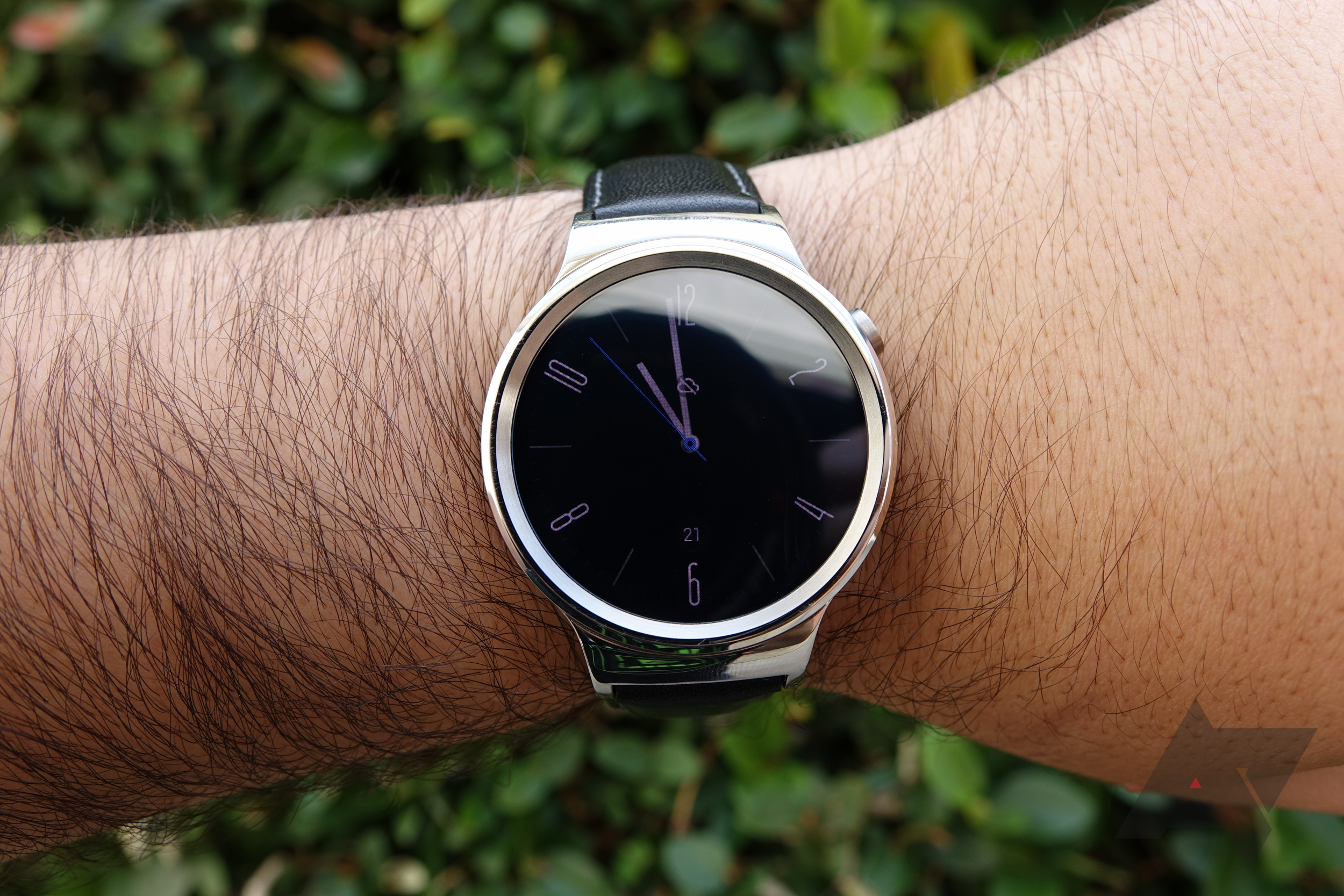 huawei smartwatch on wrist. the huawei watch is a nice smartwatch with screen, good battery life, and what i would call an above-average level of construction quality. on wrist
