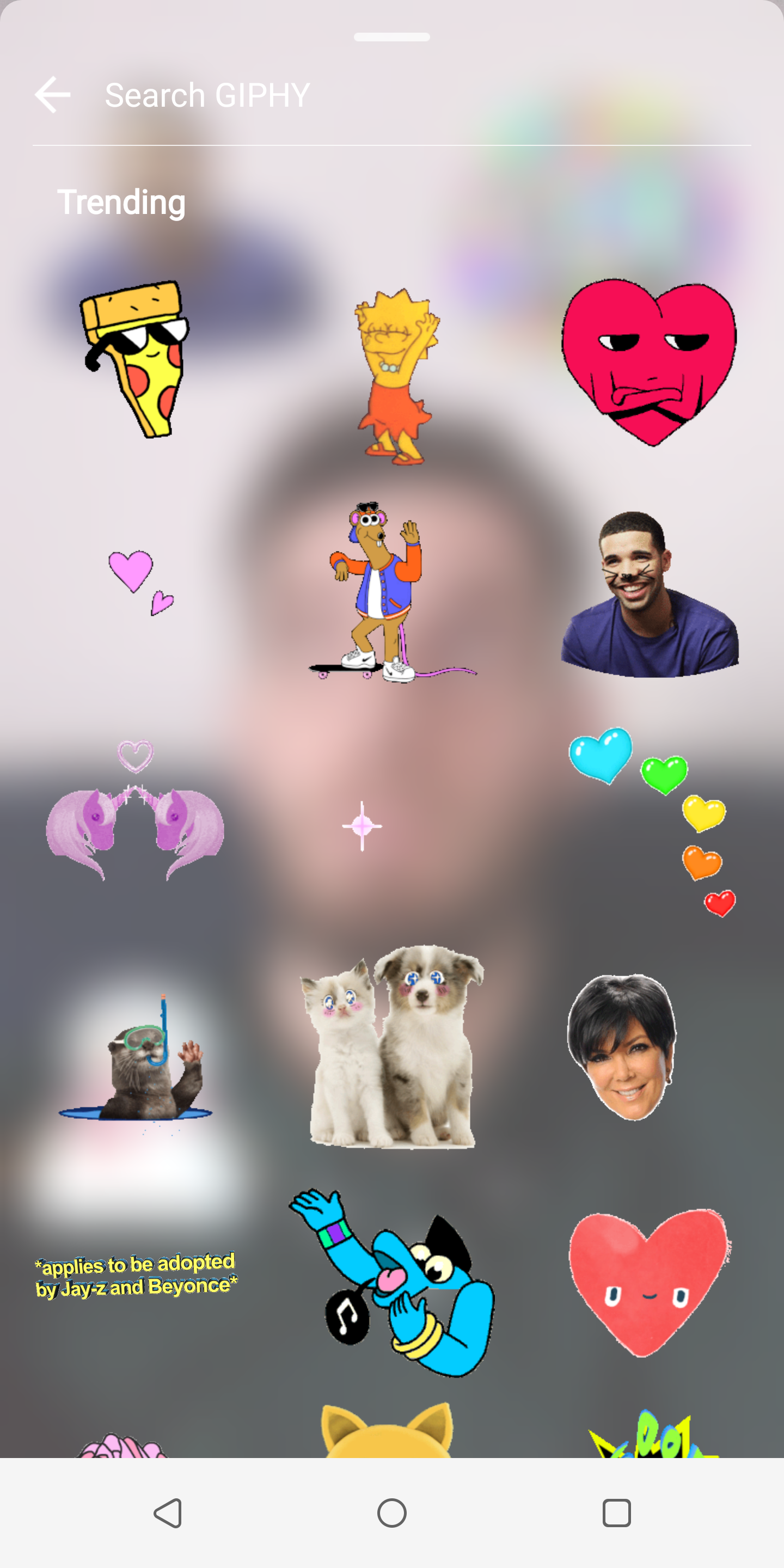 Tapping that brings up a searchable list of animated gif stickers that can be superimposed on your creation apparently there are hundreds of thousands to