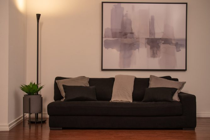 Panasonic HomeHawk FLOOR stands unobtrusively in a furnished living room.